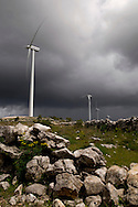 Wind turbine with approaching storm. Generally wind farms produce more with bad weather conditions.