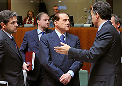Silvio Berlusconi, Italy's prime minister, center, speaks with Franco Frattini, Italy's foreign minister, right, during the European Summit, in Brussels, Belgium, Wednesday, Oct. 15, 2008.   (Photo © Jock Fistick)