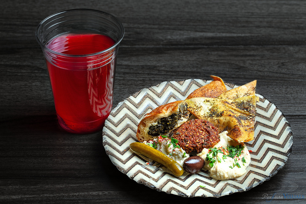 Jerusalem Market- Mezze plate and Hibiscus tea<br /> <br /> <br /> Photographed, Saturday, April 21, 2018, in Greensboro, N.C. JERRY WOLFORD and SCOTT MUTHERSBAUGH / Perfecta Visuals