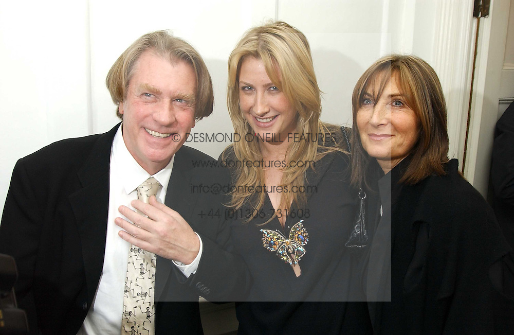 Art collector FRANK COHEN and MRS FRANK COHEN and their daughter GEORGINA COHEN at a private view of an exhibition of photographs by the late Robert Mapplethorpe curated by artist David Hockney at the Alison Jacques Gallery, 4 Clifford Street, London W1 on 13th January 2005.<br /><br />NON EXCLUSIVE - WORLD RIGHTS