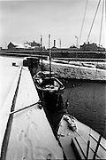 13/01/1963<br /> 01/13/1963<br /> 13 January 1963<br /> Snow scenes from Kiliney and Dun Laoghaire, Co. Dublin.  View of boats with Tedcastle - McCormick's coal dealers in backgroundd.