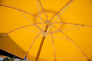 the inside of a big yellow beach umbrella