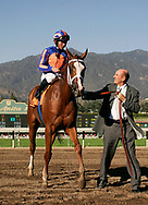 Rags to Riches with Garrett Gomez aboard is led into the winners circle by owner Michael Tabor after winning the Santa Anita Oaks at Santa Anita Park, Arcadia CA. 3.11.2007