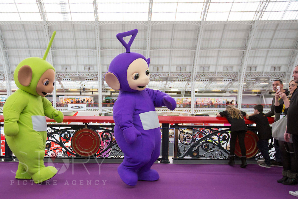 UNITED KINGDOM, London: 25 January 2016 Teletubbies take a walk through Olympia in London this morning during The Toy Fair, the UK'S only dedicated game and hobby event with more than 260 toy and gaming brands. The fair runs until tomorrow. Rick Findler  / Story Picture Agency
