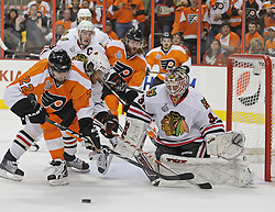 June 9, 2010; Philiadelphia, PA; USA;  Philadelphia Flyers left wing Ville Leino (22) and Chicago Blackhawks defenseman Duncan Keith (2) battle for the loose puck in front of Chicago Blackhawks goalie Antti Niemi (31) during the first period of Game 6 of the Stanley Cup Finals at the Wachovia Center.