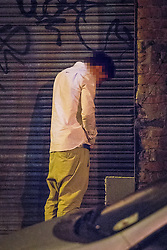 © Licensed to London News Pictures . 18/10/2013 . Manchester , UK . A man urinates against a wall in between cars near to Deansgate Locks . Greater Manchester Police campaign against anti-social micturation . Photo credit : Joel Goodman/LNP