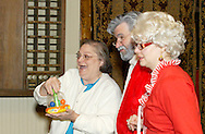 """An audience member is recruited to help sell toys on the home shopping TV show of Santa and Mrs. Claus (aka Jerry and Tamra Francis of Dayton) during Mayhem & Mystery's production of """"I'll Be Home Shopping for Christmas"""" at the Spaghetti Warehouse in downtown Dayton, Monday, November 9, 2009."""