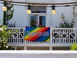 Thank you NHS rainbow sign on house during Coronavirus lockdown, Reading UK May 2020