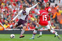 Aston Villa's Matthew Lowton and Arsenal's Alex Oxlade-Chamberlain in action  - Photo mandatory by-line: Mitch Gunn/JMP - Tel: Mobile: 07966 386802 17/08/2013 - SPORT - FOOTBALL - Emirates Stadium - London -  Arsenal V Aston Villa - Barclays Premier League