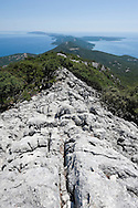 Hiking along the rocky spine of Osorscica, a mountain on the island of Losinj, Croatia