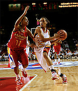 Duke  recruit Jasmine Thomas dribbles around Ohio State recruit Alison Jackson in the lane during the McDonald's All American High School Basketball Games at Freedom Hall in Louisville, Kentucky on March 28, 2007.
