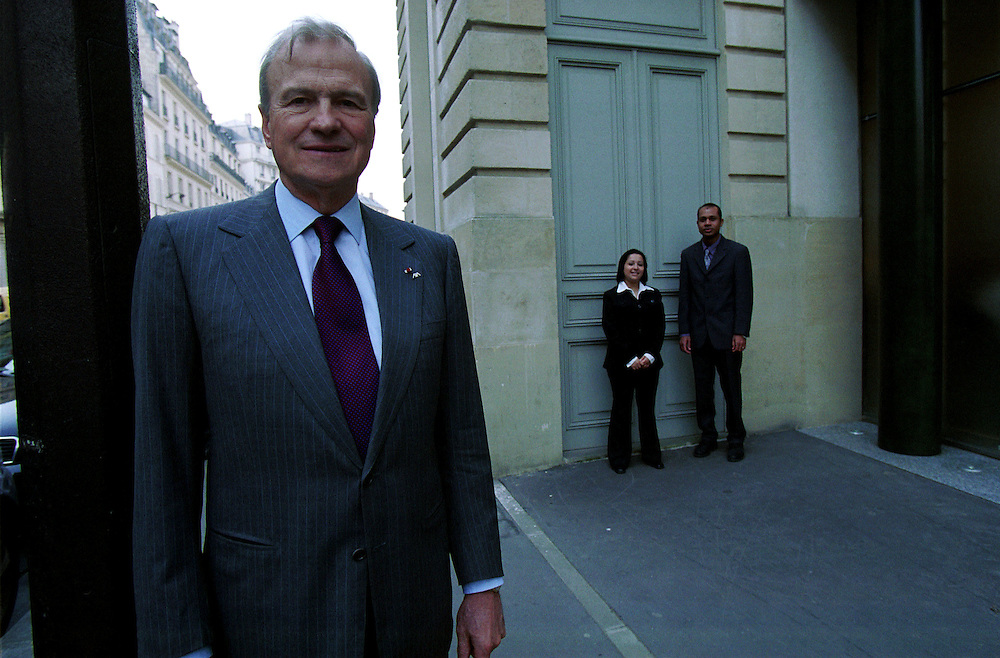 "Claude Bebear, CEO of the AXA Group, with two employees, Claudio Dialava and Sabrina Agalia, who were hired as part of AXA's policy called ""?a Va Etre Possible"" or That is Going to be Possible. The policy supports equal opportunity employment for qualified immigrant job seekers..Paris, France. 25 March 2003.Photo © J.B. Russell/Panos"