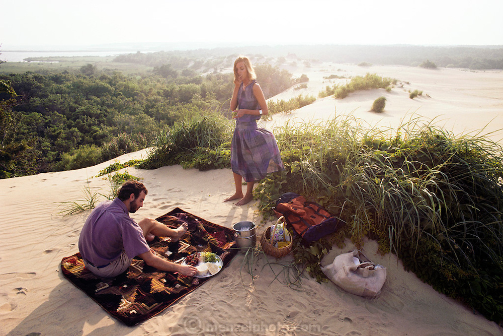 Couple at a picnic, Nags Head Woods, NC, USA. Land preserved by the Nature Conservancy. MODEL RELEASED.