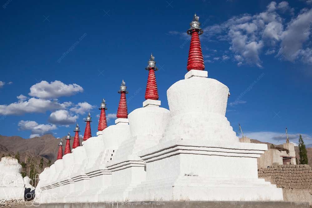 Buddhist Stupas at Thiksey Monastery, Ladakh, Northern India, Thiksey famous for having Ladakh's biggest chorten fields with hundreds of whitewashed shrines of varying sizes scattered across the desert landscape is located approximately 19 kilometers east of Leh