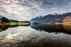 © Licensed to London News Pictures. 06/03/2020. Crummock UK. The mountains that surround Crummock Water lake in Cumbria reflect in the calm water this morning. Photo credit: Andrew McCaren/LNP