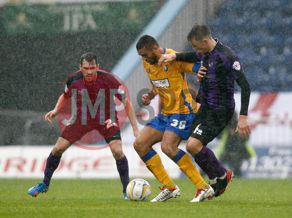 Bristol Rovers' Ollie Clarke and Bristol Rovers' Michael Smith battle with Mansfield Town's Colin Daniel - Photo mandatory by-line: Matt Bunn/JMP - Tel: Mobile: 07966 386802 12/10/2013 - SPORT - FOOTBALL - Field Mill - Mansfield - Mansfield Town V Bristol Rovers - Sky Bet League 2