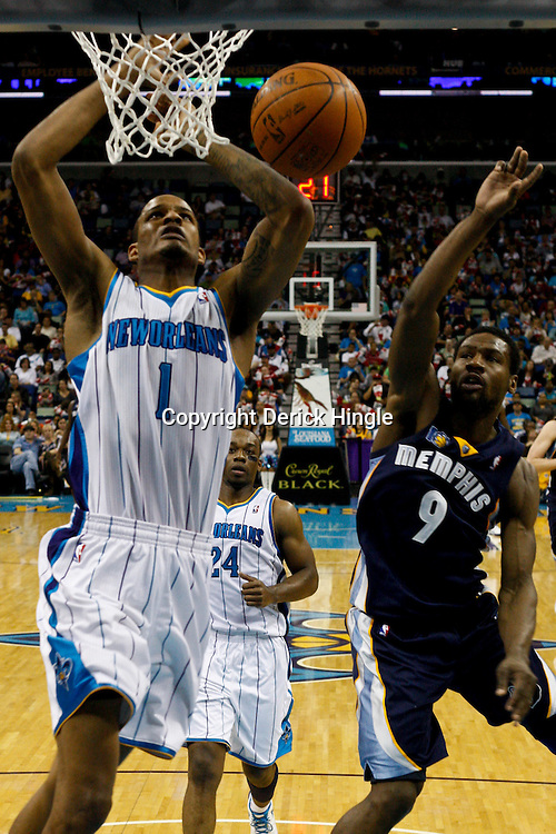 April 1, 2011; New Orleans, LA, USA; New Orleans Hornets small forward Trevor Ariza (1) loses the ball as he goes up for a dunk as Memphis Grizzlies shooting guard Tony Allen (9) trails the play during the second half at the New Orleans Arena. The Grizzlies defeated the Hornets 93-81.   Mandatory Credit: Derick E. Hingle