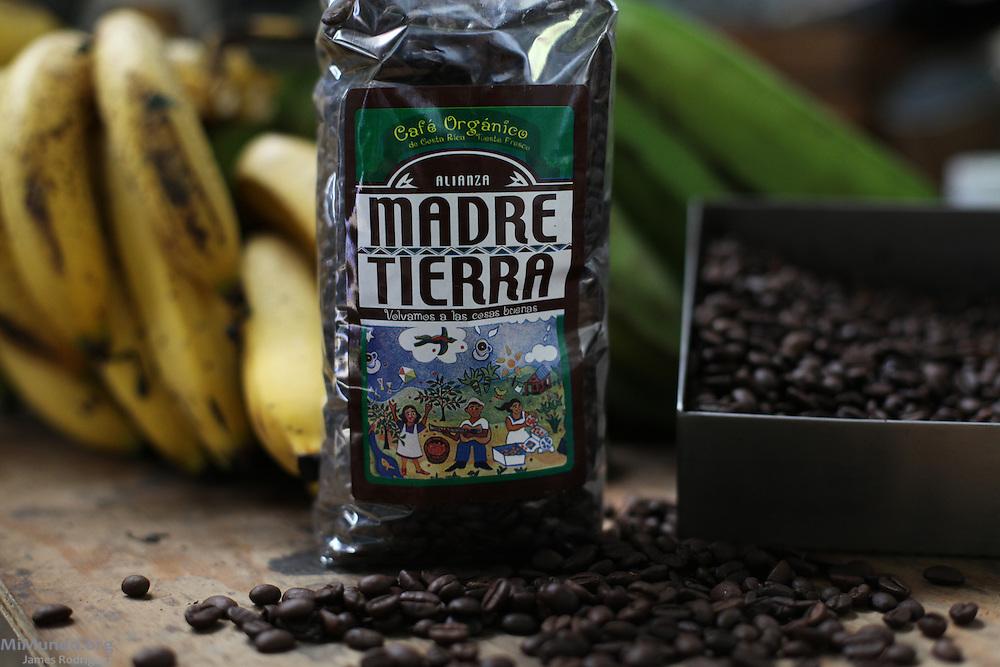 Roasted coffee beans, bananas and a Madre Tierra brand coffee pack. La Alianza Madre Tierra Co-Op, San Rafael Norte, Pérez Zeledón, San José, Costa Rica. August 28, 2012.