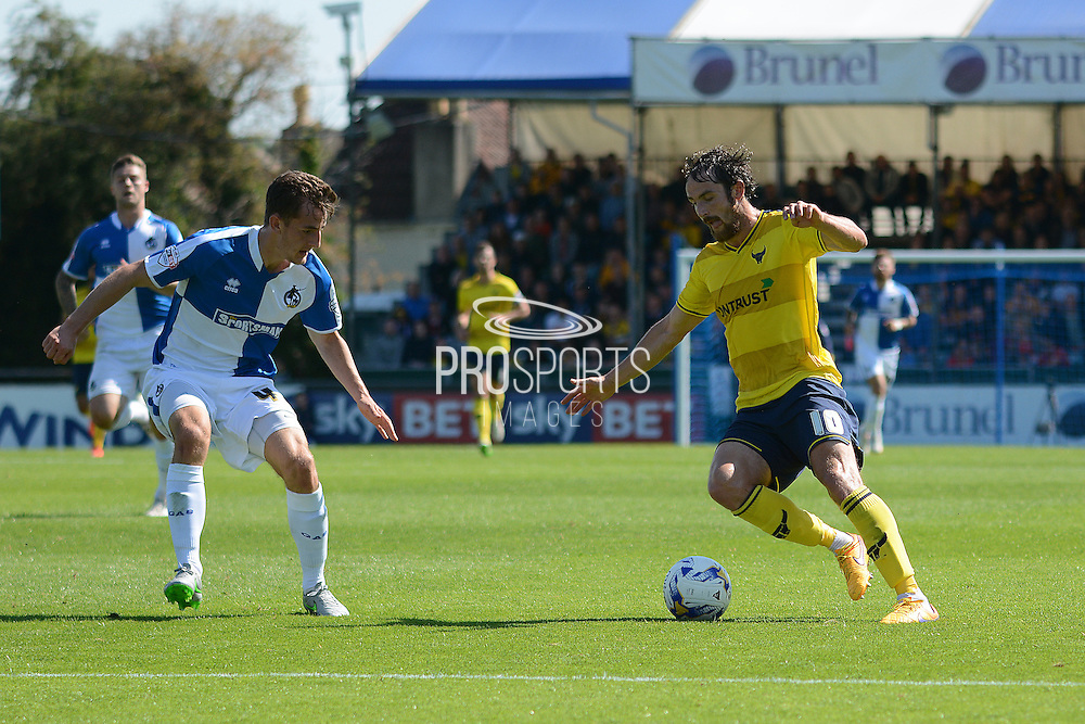 Tom Lockyer holds up Danny Hylton during the Sky Bet League 2 match between Bristol Rovers and Oxford United at the Memorial Stadium, Bristol, England on 6 September 2015. Photo by Alan Franklin.
