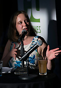 """Reporter Lindsay Christians poses a question for guest Nyanyika Banda during the """"Corner Table Podcast"""" recording at Old Sugar Distillery in Madison, Wisconsin, Tuesday, June 18, 2019."""