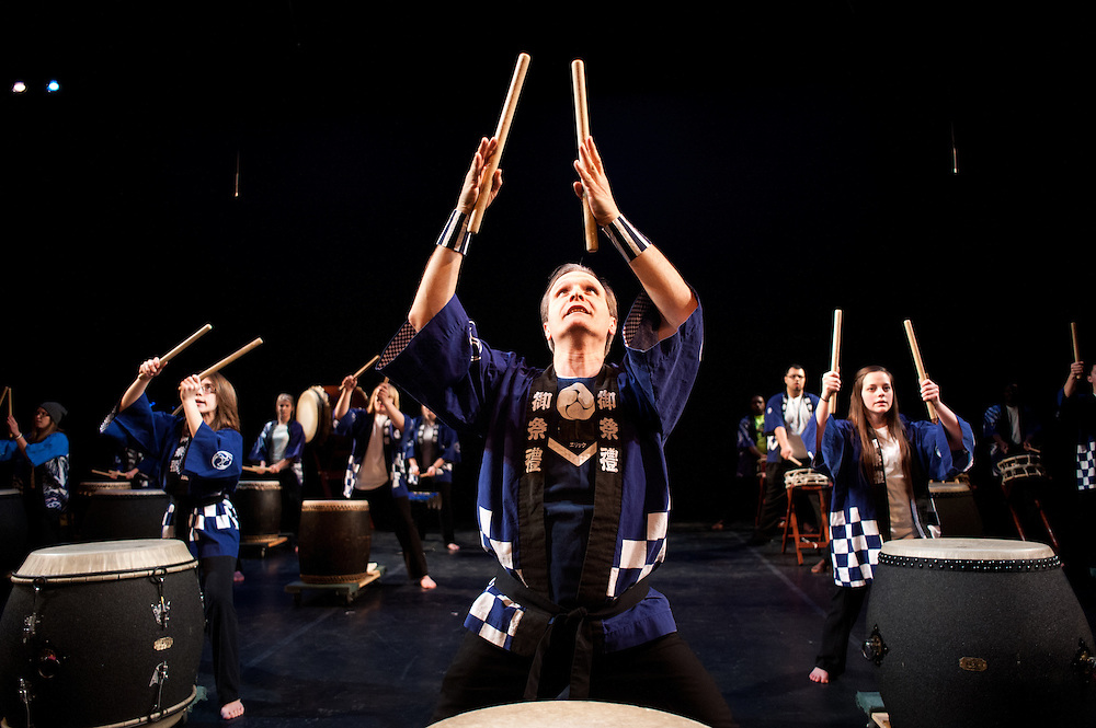 Director and Composer Eric Paton leads the Ohio University Taiko Ensemble during a dress rehearsal for the third annual Global Excusions World Music and Dance Festival, which was held in the Templeton-Blackburn Alumni Memorial Auditorium on Saturday.  Photo by: Ross Brinkerhoff.