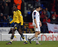 Photo: Paul Greenwood.<br />Bolton Wanderers v Arsenal. The FA Cup. 14/02/2007. Bolton's Tal Ben Haim, right, walks off the field after recieving a red card