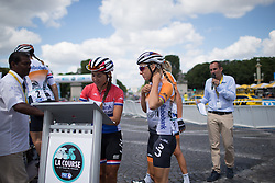 Anouska Koster (NED) and Pauline Ferrand-Prevot (FRA) of Rabo-Liv Cycling Team sign on before the La Course, a 89 km road race in Paris on July 24, 2016 in France.