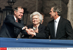 © Ron T. Ennis/KRT/ABACA. 41282-1. Austin-TX-USA. 19/01/1999. Texas Gov. George W. Bush, right, is congratulated by his father, former president George Bush, and his mother Barbara Bush after taking the oath of office. The younger Bush is rumored to be a