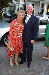 DAME VIVIEN DUFFIELD and SIR JOCELYN STEVENS at Sir David & Lady Carina Frost's annual summer party held in Carlyle Square, London on 6th July 2004.