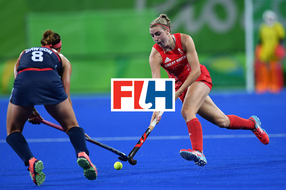 USA's Rachel Dawson (L) and Britain's Lily Owsley vie during the women's field hockey Britain vs the USA match of the Rio 2016 Olympics Games at the Olympic Hockey Centre in Rio de Janeiro on August, 13 2016. / AFP / MANAN VATSYAYANA        (Photo credit should read MANAN VATSYAYANA/AFP/Getty Images)