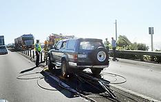 Paekakariki-Car straddles median barrier blocking SH1