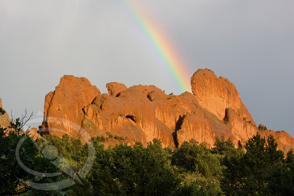 A rainbow hits the red rocks after the storm.  Garden of the Gods, Colorado Springs, Colorado