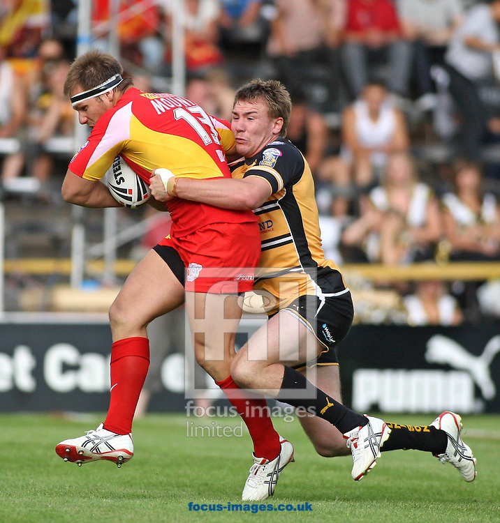 Castleford - Saturday 27th June 2009: Gregory Mounis of the Catalans Dragons is tackled by Michael Shenton of Castleford during the Engage Super League match at Castleford. (Pic by Steven Price/Focus Images)