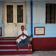 May 09, 2013 - Yangon, Myanmar: A devotee prays at Sule Pagoda in central Yangon. CREDIT: Paulo Nunes dos Santos