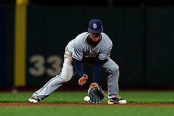 SAN FRANCISCO, CA - SEPTEMBER 24: Wil Myers #4 of the San Diego Padres fields a ground ball against the San Francisco Giants during the ninth inning at AT&T Park on September 24, 2018 in San Francisco, California. The San Diego Padres defeated the San Francisco Giants 5-0. (Photo by Jason O. Watson/Getty Images) *** Local Caption *** Wil Myers
