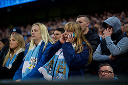 MANCHESTER, ENGLAND - Saturday, April 7, 2018: Manchester City supporter look dejected as they watch their side throw away a two-goal lead to lose 3-2 during the FA Premier League match between Manchester City FC and Manchester United FC at the City of Manchester Stadium. (Pic by David Rawcliffe/Propaganda)