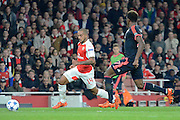 Arsenal striker Theo Walcott on the attack during the Champions League  Group F match between Arsenal and Bayern Munich at the Emirates Stadium, London, England on 20 October 2015. Photo by Alan Franklin.