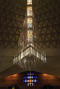A kinetic sculpture by Richard Lippold sits above the altar at Cathedral of St. Mary of the Assumption, San Francisco, California. Fifteen stories high and weighing one ton, this modern piece consists of 14 tiers of triangular aluminum rods.