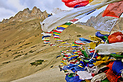 Buddhist peace flags blowing in the wind at the border between Kashmir and Ladakh in India