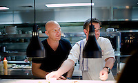 Sydney FC lunch at Peter Sullivan and Matt Moran's new Restaurant Chiswick House in Woollarah. Matt Moran and Simon Sandal in the kitchen.