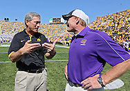 September 15 2012: Iowa Hawkeyes head coach Kirk Ferentz talks with Northern Iowa Panthers head coach Mark Farley before the start of the NCAA football game between the Northern Iowa Panthers and the Iowa Hawkeyes at Kinnick Stadium in Iowa City, Iowa on Saturday September 15, 2012. Iowa defeated Northern Iowa 27-16.