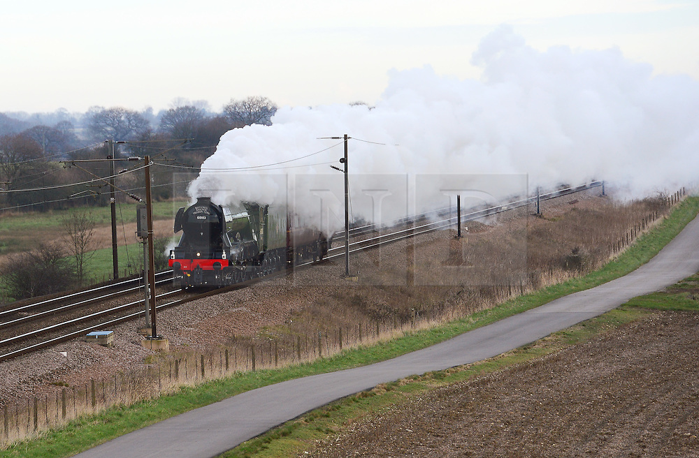 © Licensed to London News Pictures. 24/02/2016. York, UK. The Flying Scotsman makes its way to London on the east coast mainline outside York ahead of the Inaugural Run from Kings Cross to York tomorrow. Photo credit : Anna Gowthorpe/LNP