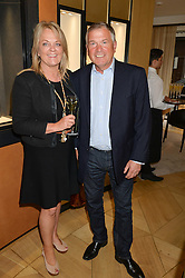 PETER & ANGELA BARFOOT he is Chairman of Cowdray Polo Club at the draw for the Jaeger-LeCoultre Gold Cup held at Jaeger-LeCoultre, 13 Old Bond Street, London on 8th June 2015.