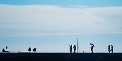 © Licenced to London News Pictures. Aberystwyth, UK. 22/07/2018. People at the seaside in Aberystwyth on a gloriously hot and sunny Sunday in west wales. The UK wide heatwave continues, with no respite from the very dry weather and temperatures are expected to exceed 30ºc again by the end of the week. Photo credit: Keith Morris/LNP
