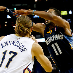 Dec 13, 2013; New Orleans, LA, USA; Memphis Grizzlies point guard Mike Conley (11) is defended by New Orleans Pelicans power forward Lou Amundson (17) during the second half of a game at New Orleans Arena. The Pelicans defeated the Grizzlies 104-98. Mandatory Credit: Derick E. Hingle-USA TODAY Sports