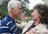 Florida Governor Charlie Crist greets Tampa Mayor Pam Iorio before the start of the 2007 Gasparilla parade in Tampa, Florida.