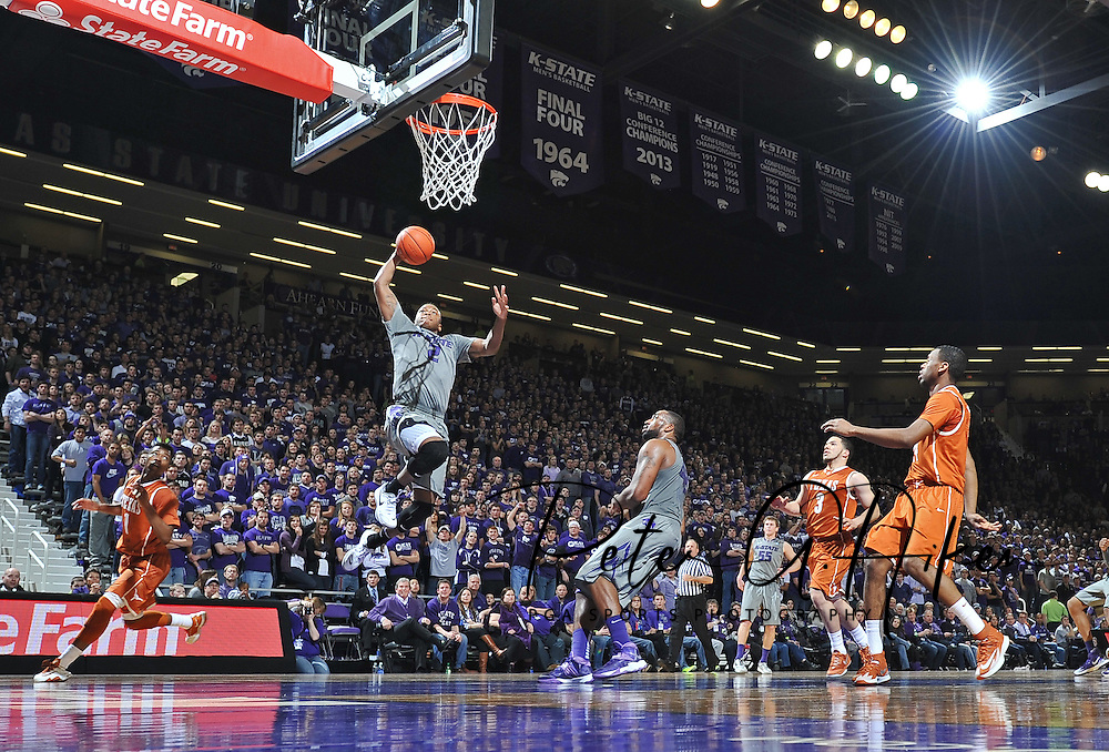 Guard Marcus Foster #2 of the Kansas State Wildcats drives to the basket for a dunk against the Texas Longhorns during the second half on February 8, 2014 at Bramlage Coliseum in Manhattan, Kansas.