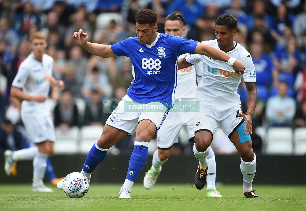 Birmingham City's Che Adams (left) and Swansea City's Kyle Naughton (right) during the pre-season match at St Andrews, Birmingham.