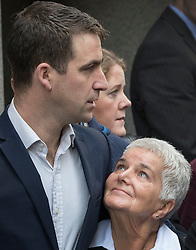 © Licensed to London News Pictures. 23/11/2016. London, UK. Family of murdered MP Jo Cox speak to reporters after Thomas Mair was found guilty of her murder. Jo Cox's mother Jean Leadbeater looks up to Jo's husband Brendan Cox after he spoke to reporters outside The Old Bailey .Defendant Thomas Mair chose not to give any evidence in his defence.  Mair shot and stabbed the 41-year-old Member of Parliament outside her constituency surgery in Birstall, near Leeds, Yorkshire on June 16 this year and has been given a whole life sentence. Photo credit: Peter Macdiarmid/LNP