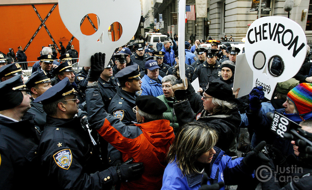 Protestors standoff with police before being arrested during a protest against the United States' involvement in Iraq near the New York Stock Exchange in New York, New York on Monday 19 March 2007.
